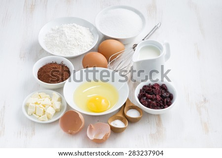 fresh ingredients for baking on a white table, top view, horizontal - stock photo