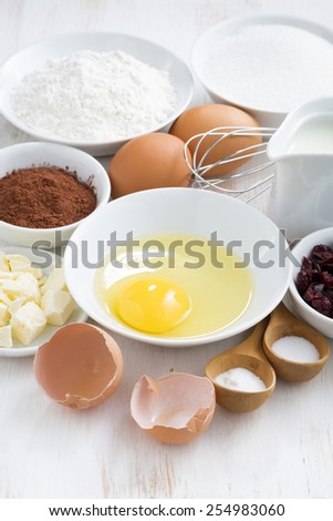 fresh ingredients for baking on a white table, vertical, top view - stock photo