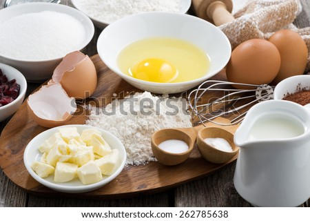fresh ingredients for baking on a wooden board, close-up - stock photo