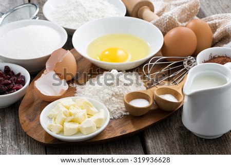 fresh ingredients for baking on a wooden board, horizontal, close-up - stock photo