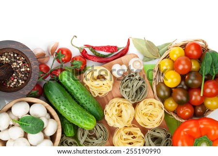 Fresh ingredients for cooking: pasta, tomato, cucumber, mushroom and spices. Isolated on white background - stock photo