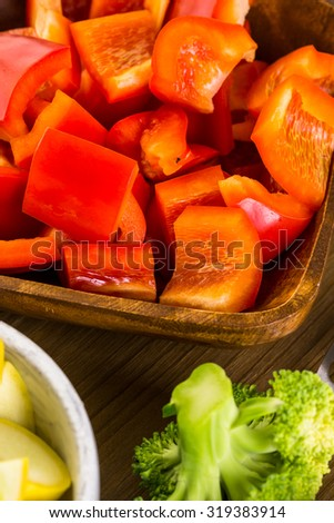 Fresh ingredients for preparing roasted mixed vegetables on the table.