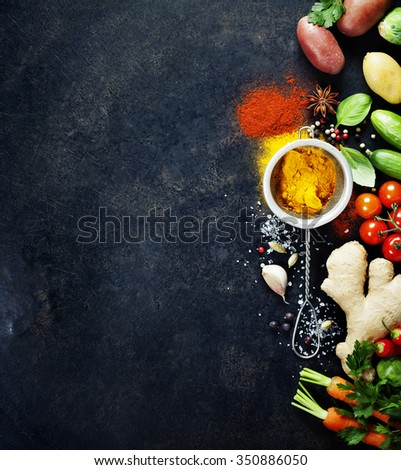 Fresh  ingredients on dark background. Vegetarian food, health or cooking concept. Background layout with free text space. - stock photo