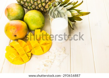 Fresh ingredients on the table to make smoothie with tropical fruits.