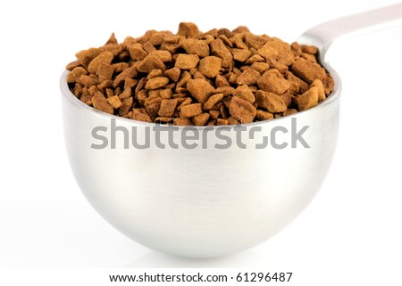 fresh instant gourmet coffee scoop isolated against white background