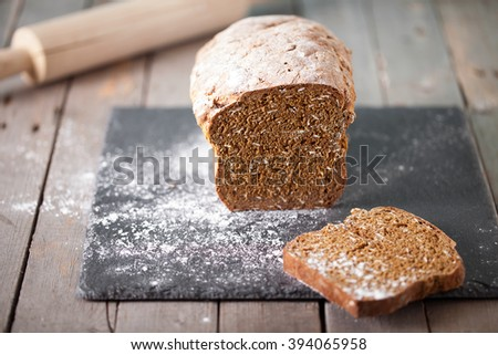 Fresh Irish soda bread with oat sliced on a slate cutting board Wooden background Copy space Selective focus - stock photo