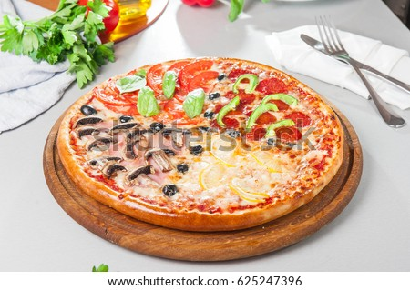 Nice Fresh Italian Four Seasons Pizza (Pizza Quattro Stagioni) On The Wooden  Board On The