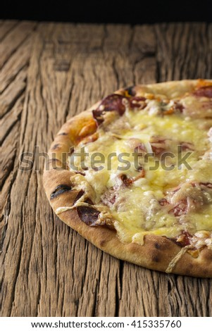 Fresh italian pizza served on a rustic wooden table. - stock photo