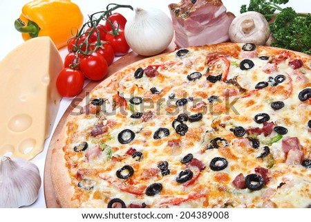 Fresh italian pizza with olives,mashrooms and ham, on a thick dough with ingredients on a white background.