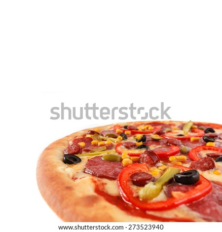 Fresh Italian pizza with salami, sausage, frankfurters, red pepper, cucumber, corn, green and black olives isolated on white
