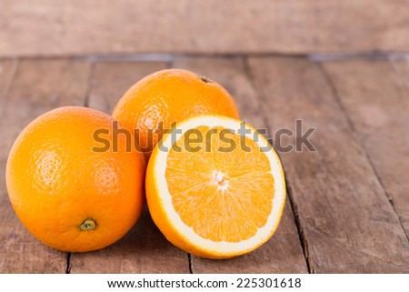 fresh, jucy,  orange on  a wooden background - stock photo