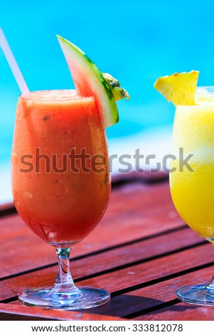 Fresh juice cocktails near the swimming pool - stock photo