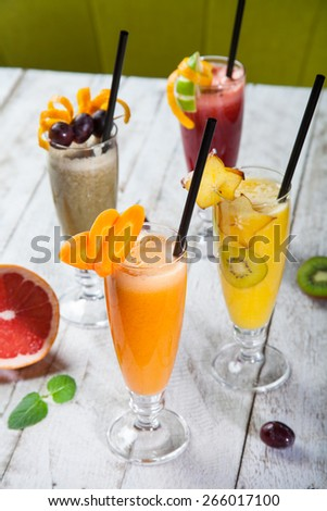 fresh juice from fruits and vegetables in a glass. Photo on a white background - stock photo