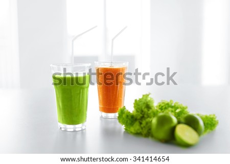 Fresh Juice. Green And Orange Organic Vegetable Blended Smoothie In The Glass. Detox Diet. Healthy Drink, Eating, Food. Vitamins. Healthy Lifestyle Concept. - stock photo