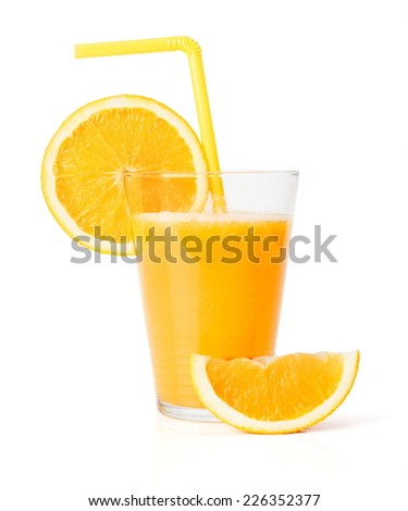Fresh juice in glass with orange slice and straw