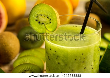 fresh juice made from kiwi fruit close up - stock photo