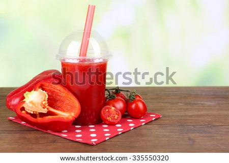 Fresh juice mix fruit and vegetables, healthy drinks on wooden table, on light background - stock photo