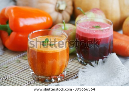 Fresh juice, mix fruits and vegetable on a wooden table. Healthy food