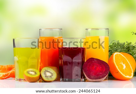 Fresh juice, mix fruits and vegetable with nature green background - stock photo