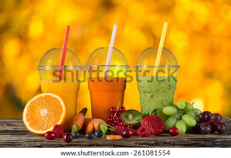 Fresh juice mix vegetables and fruit, healthy drinks on wooden table. - stock photo