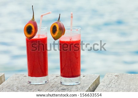 fresh juice or cocktail in cup, bali, indonesia - stock photo