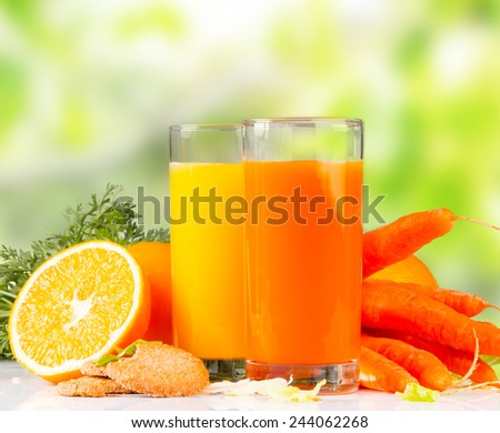 Fresh juice orange and carrot,Healthy drink on white table  - stock photo