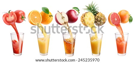 Fresh juice pours from fruits and vegetables in a glass. Clipping path. On a white background. - stock photo