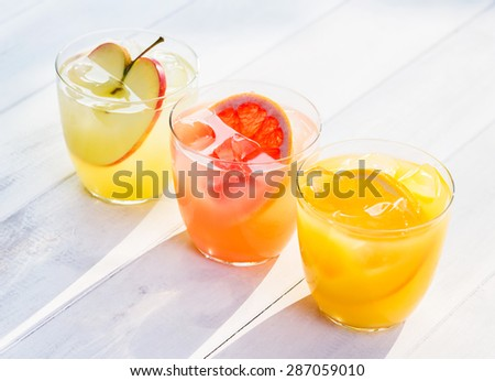 Fresh juices of oranges  red grapefruits apples  - stock photo