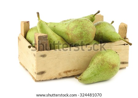 fresh juicy conference pears in a wooden box on a white background - stock photo