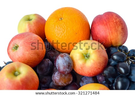 Fresh juicy fruit - apples, orange, plums and grapes. - stock photo
