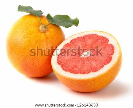 Fresh juicy grapefruits with green leaf - stock photo