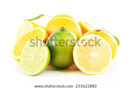 Fresh juicy limes and oranges isolated on white - stock photo