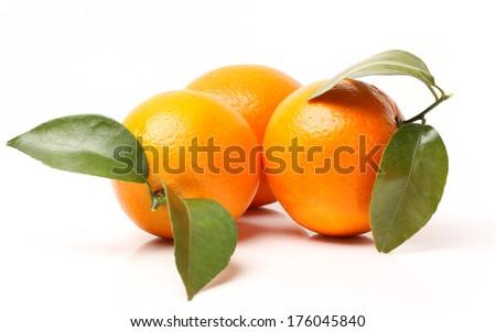 Fresh juicy oranges isolated on white  - stock photo