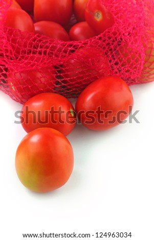Fresh juicy organic tomatoes on white background. The fruits are ripe and bright red in color and ready for consumption - stock photo