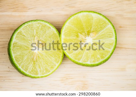 Fresh Juicy ripe lemon and slice  on wooden table,Top view  - stock photo