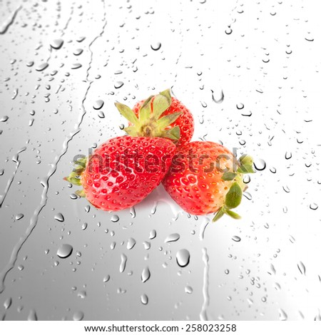 Fresh juicy strawberries on wet surfaces or Water drops background - stock photo