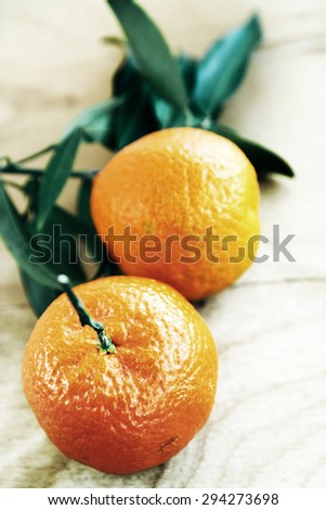 Fresh juicy tangerines on a wooden board - stock photo