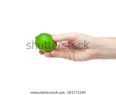 Fresh juicy tasty green lime in a human hand isolated on a white background - stock photo