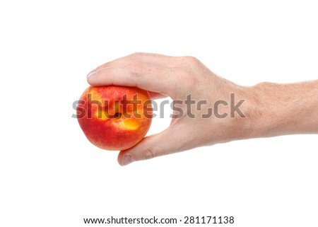 fresh juicy tasty red and yellow peach in a human hand isolated on a white background