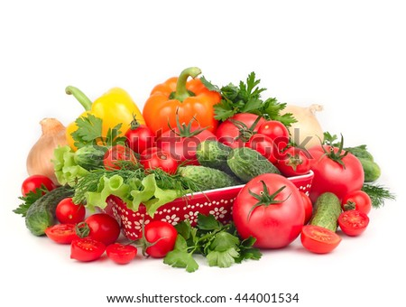 Fresh juicy vegetables on a white background with space for the text. - stock photo