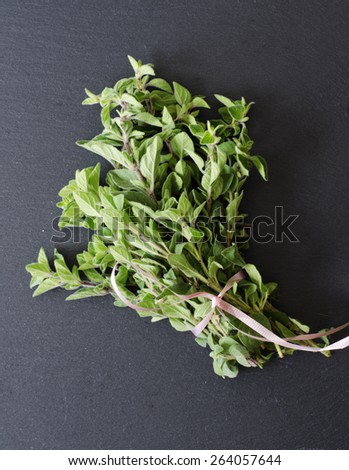Fresh Kitchen Herbs for lamb oregano, mint, rosemary, lemon thyme on black stone as texture or background - stock photo