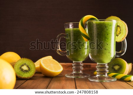Fresh kiwi cocktail beverage on table - stock photo