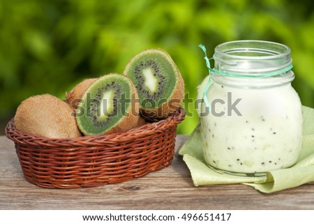 fresh kiwi fruit in a basket on a wooden table