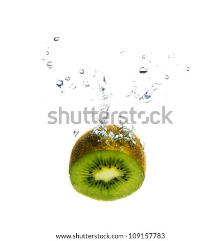 Fresh kiwi fruit splashing in the water isolated on white background with bubbles