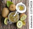 Fresh kiwi jam in a preserving glass - stock photo