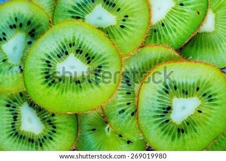 fresh kiwi, sliced of fresh kiwi, kiwi background - stock photo