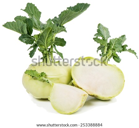 fresh kohlrabi cabbage and a cut one isolated on a white background - stock photo