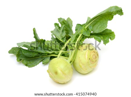 Fresh kohlrabi with green leaves on isolated white backround