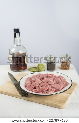 Fresh lamb sweetbreads and some ingredients to cook them - stock photo