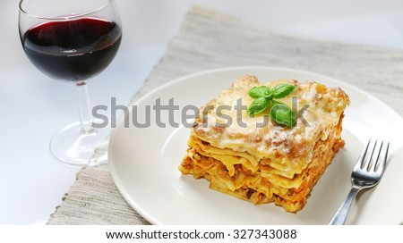 Fresh lasagna with meat and basil